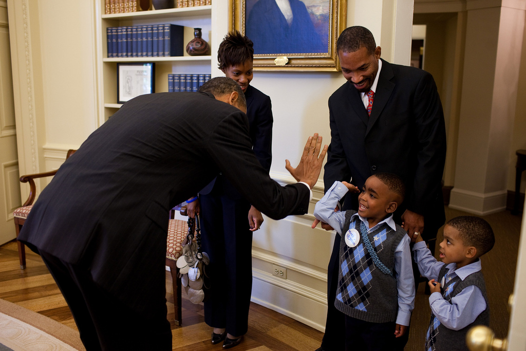 President Barack Obama gives Make-a-Wish child, Chase Kerr, a high-five during a greeting with Chase and his family in the Oval Office, Sept. 29, 2009.