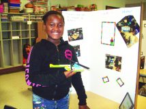 Diamond Walker of Horizons on the Hudson Elementary School stands in front of the posterboard she created, detailing her experiences at the three week LEGO Academy she attended at Gardnertown Elementary School in July. The Academy, allows students from three Newburgh Enlarged City School District Elementary Schools the unique opportunity to sharpen their group, creative thinking and technology abilities while creating an assortment of LEGO projects.