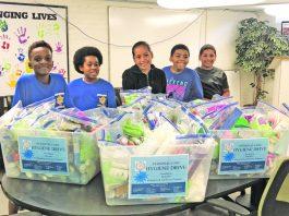 Youth members of the Middletown YMCA Leaders Club prepare hygiene kits at RECAP's food pantry in Middletown.