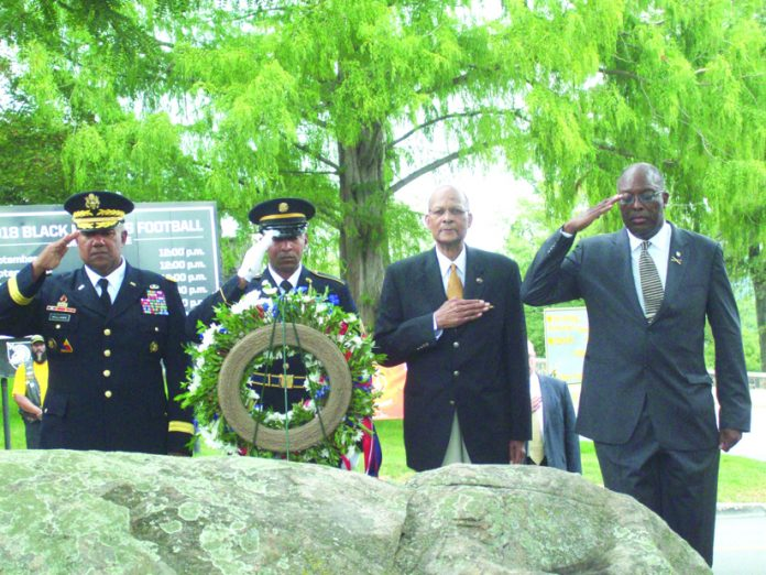 Some of the major dignitaries involved in Sunday's Buffalo Soldier event, stand at salute, while the annual wreath dedication segment takes place. The group were some of a large crowd that turned out on the US Military Academy grounds to honor the courageous African American soldiers, stationed at West Point while fighting to defend this country.