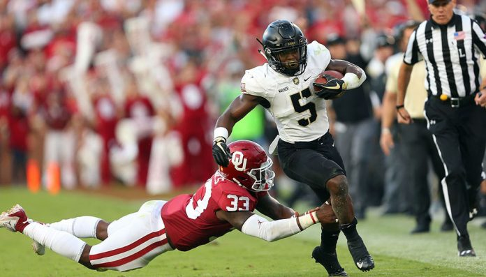 The Black Knights came to play at fifth-ranked Oklahoma on Saturday night, forcing overtime, but the Sooners escaped with the 28-21 victory . Army Black Knights Kell Walker (5) finished with a season best 80 yards on the ground. Photo: Danny Wild