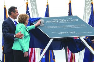 Governor Andrew Cuomo and his mother, Matilda, unveil the plaque marking the naming of the Governor Mario M. Cuomo Bridge at Tappan Zee. Matilda assisted in the unveiling of the bridge named for the current governor's father and her late husband.