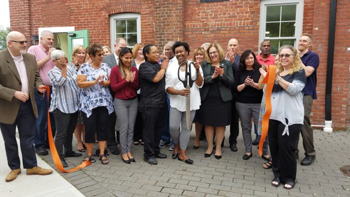 Staff and supporters of RECAP's Mill Street Café at the site's ribbon cutting ceremony on Friday, September 14.