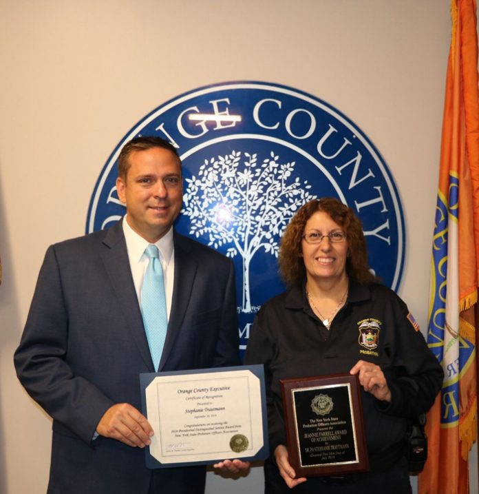 Orange County Executive Steven M. Neuhaus and Probation Officer Stephanie Trautmann.