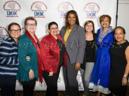 New York State Attorney General Candidate Letitia James, center, poses with members of the Latino Democratic Committee of Orange County during the organizations Fifteenth Annual Fall Dinner Dance at Cafe Internationale in Newburgh, NY on Saturday, October 13, 2018. Hudson Valley Press/CHUCK STEWART, JR.