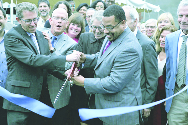 City of Newburgh Mayor Torrance Harvey, right, cuts the ceremonial ribbon as the Newburgh RUPCO project is dedicated.