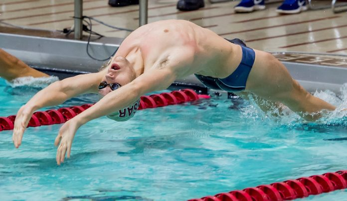 Max White of the Vassar College men's swimming & diving team set a Kresge Pool record in the 200 yard backstroke on Saturday.