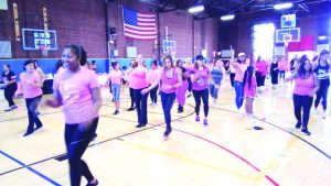"Participants in Sunday's ""Party in Pink"" event enjoy themselves at the Zumba portion, aimed at raising awareness and funding for breast cancer at the Newburgh Armory Unity Center."