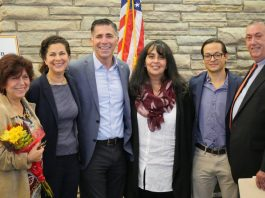 Pictured from left to right: Dolores Quiles, ESL Professor at SUNY Ulster; Alexandra Baer, Director of Unison Arts Center; Ulster County Executive Mike Hein; Maria Elena Ferrer-Harrington, Director of Community Engagement at Health Alliance; Noe Del Cid, Owner of Peace Nation Café; and Arnaldo Sehwerert, Regional Director of Mid-Hudson Small Business Development Center.