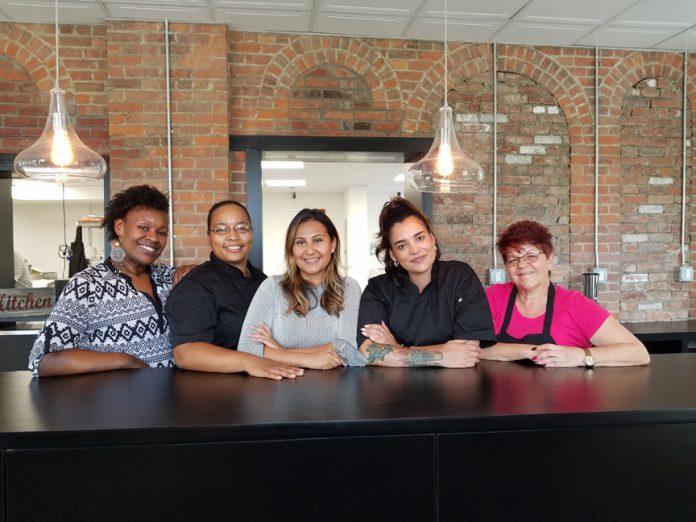 Charlene Woodson, Justine Figueroa, Melida Lopez, Christine Cordero Lazar and Sharon Delgado at Mill Street Café in Middletown.