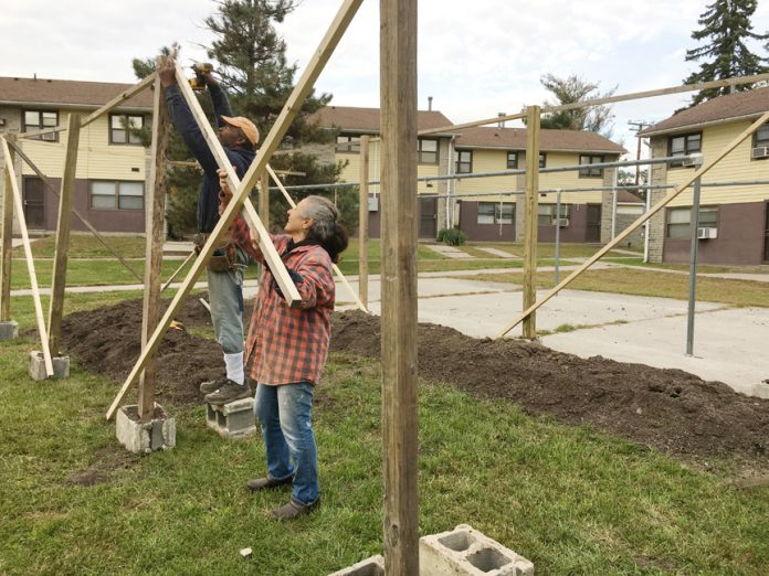 Shabazz Jackson and Josephine help construct the Lillie Howard Urban Community Garden at the Mullins Courtyard Apartments located at 40 Walsh Road in Newburgh.