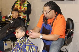 Master Barber Darrelll Burns donated free haircuts at We Are Newburgh's 4th Annual Thanksgiving Giveback.