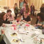 """Women painted glasses at """"What Women Want"""" with Created With Love Boutique."""