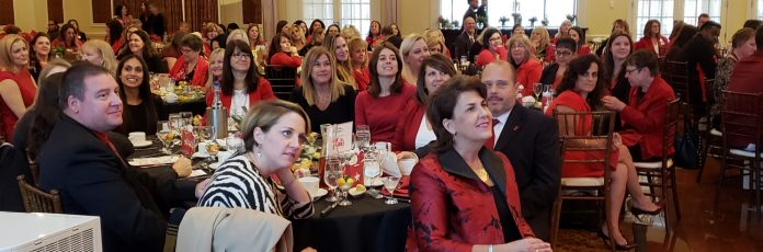 Denise Doring VanBuren, (right foreground) joined the more than 360 people, mostly women dressed in red, at The American Heart Association's 11th Annual Go Red For Women Luncheon on Friday. The event raises awareness and funds to fight women's number one killer - heart disease. VanBuren will serve as the event's Chair next year.