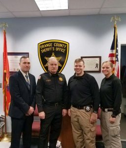 From Left to Right: Sr. Inv. Tim Riordan, Sheriff Carl DuBois, Inv. Joe Morales, and Inv. Kelsey McDonough pose for a photo.