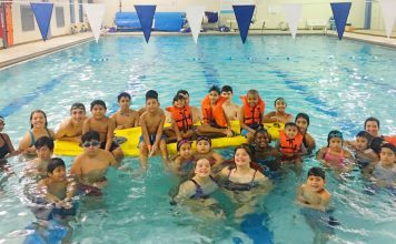 Group shot of some of the participants at the America Rows and Swims Newburgh open house.