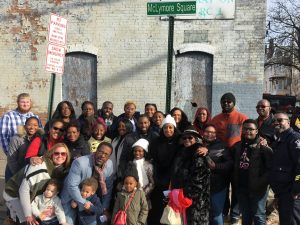 The Life Restoration Church family posed for a photo in front of the new street signed named after their pastor RD McLymore.