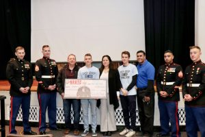Dylan Dellatore, a 12th grade scholar at Newburgh Free Academy's North Campus was presented a scholarship for $180,000 by Captain Matt Silverstein, USMC during a senior assembly at Newburgh Free Academy's North campus on Thursday, December 20, 2018.
