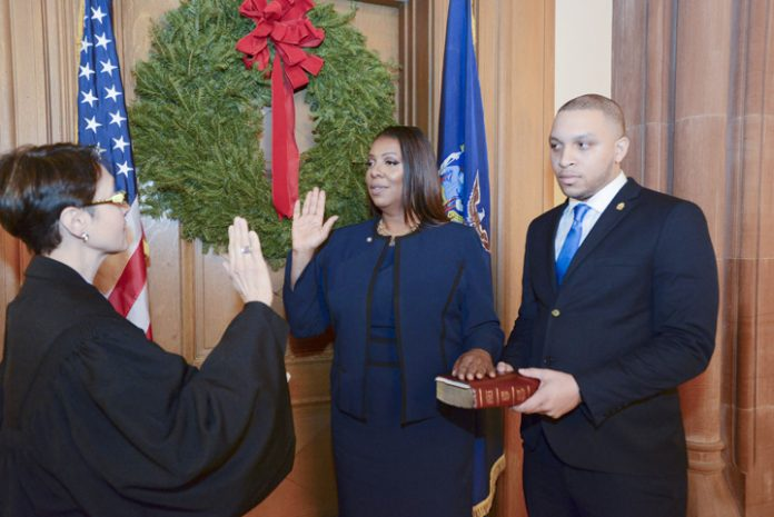 Letitia James takes oath of office at state capitol in Albany.