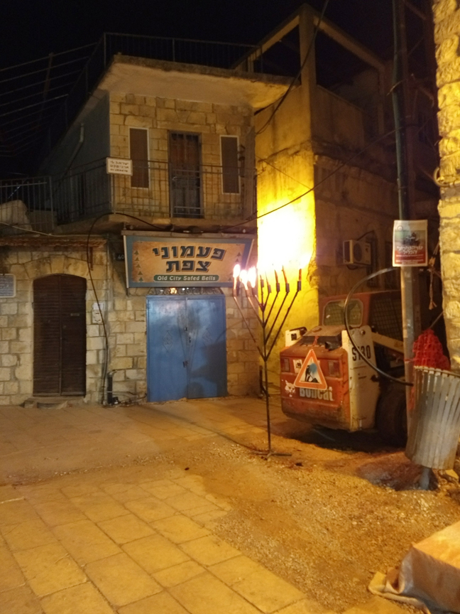 A menorah lights the path of a small town in Israel, where Mount Associate Professor of Psychology Yasmine Kalkstein spent Chanukkah last year.