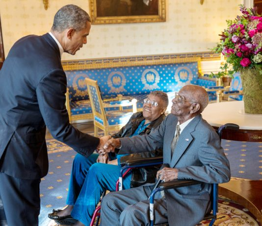 President Barack Obama greets Richard Overton, with Earlene Love-Karo, in the Blue Room of the White House, on November 11, 2013. Mr. Overton, was 107 at the time, and was the oldest living World War II veteran, attending the Veteran's Day Breakfast at the White House. White House Photo: Lawrence Jackson