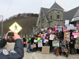 Port Jervis Police and Fire Department assisted with traffic and the peaceful march, also assisting with someone's cell phone photo during this group photo shot.