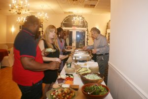 Project L.I.F.E. staff enjoy their first Annual Christmas Recognition Banquet. Photo: Craig Brown