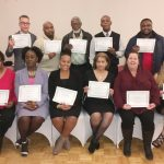 Project L.I.F.E. staff pose with their certificates at their their 1st Annual Christmas Recognition Banquet.
