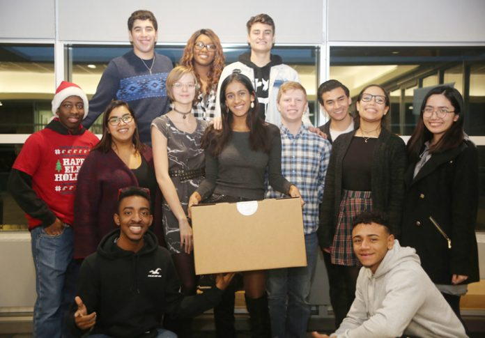 RCC students gather to distribute holiday meal boxes.