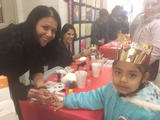 Dora Fernandez puts some face painting touches on Poughkeepsie 11 year old, Esmeralda Gonzalez at Saturday's Three Kings Day event.