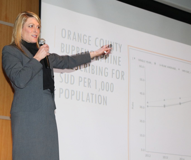 "Darcie Miller, Orange County's Commissioner of Social Services and Mental Health, speaks to the audience at the ""Changing the Orange County Addiction Treatment Ecosystem"" on Friday, January 18th at the County's Emergency Services Center."