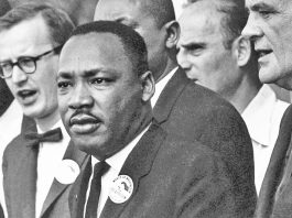 """In 1967 Dr. King advised his Stanford University audience, """"Somewhere we must come to see that social progress never rolls in on the wheels of inevitability. It comes through the tireless efforts and the persistent work of dedicated individuals…. And so, we must help time, and we must realize that the time is always right to do right."""""""