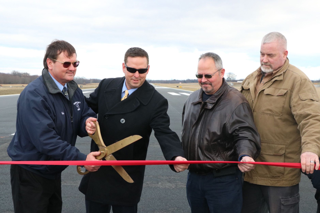 From left to right) Ed Magryta, Orange County's Director of Aviation, Orange County Executive Steven M. Neuhaus, Chairman of the Legislature Steve Brescia and Town of Montgomery Supervisor Rod Winchell on Orange County Airport's new runway.