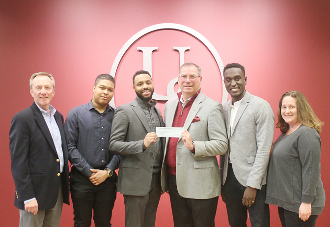 Brothers at Bard receives a $2,000 check from Ulster Savings Charitable Foundation. Pictured (from left to right) John Finch, Ulster Savings Bank EVP/COO; Dereck Chavez, BAB mentor; Dariel Vasquez, Founder and Co-Director, BAB; Bill Calderara, President and CEO, Ulster Savings Bank; Harry Johnson, Co-Director, BAB; and Lisa Daggett, Grant Writer, Bard College.