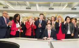 Governor Andrew Cuomo signs the Child Victims Act in the newsroom of the Daily News.