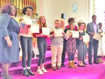 Winners of the 6th Annual MLK Community Essay Contest reveal their certificates at Saturday's 41st Annual Reverend Dr. Martin Luther King, Jr. Birthday Celebration, held at Beacon's Springfield Baptist Church.