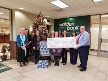 Walden Savings Bank presented a donation to Safe Homes as part of its 22 Days of Giving Campaign. Pictured from left to right are: Linda Welch, Nancy Schoen, Maryanne Weber, Jocelynne Piccolo, Safe Homes Representative - Stephanie Molinelli, Emily Ramos, Kim Gallo, Lisa Gariolo, Peter Fuchs.