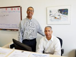 Sam and Newburgh Services office assistant Kevin Powell at RECAP's Newburgh Service Office in Newburgh.