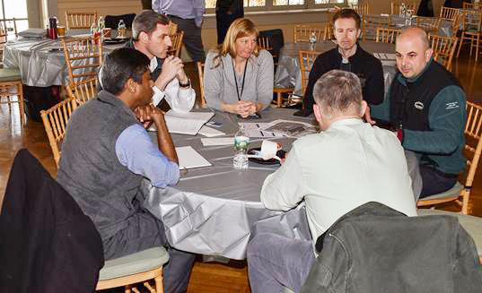 Nearly 100 professionals attended Central Hudson's ninth annual Solar Summit, covering the latest technical and regulatory advances in support of solar power. Central Hudson representatives Carrine Brown, (center), and Jason Malizia, (right), review a solar project with developers.