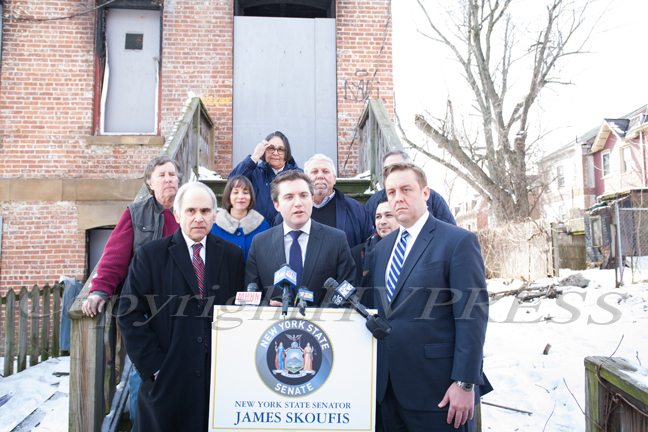 New York State Senator James Skoufis (D-39), Chairman of the New York State Senate Committee on Investigations and Government Operations, is surrounded by local elected officials and code enforcement officers, as he announced Friday an investigation into housing conditions and code enforcement during a press conference at 197 First Street in Newburgh, NY.