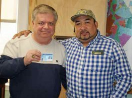 John Naumchik and Eusebio Bautista pose for a photo, as residents in Middletown gathered at the city clerk's office at City Hall the first thing last Wednesday morning to secure the new municipal identification cards.