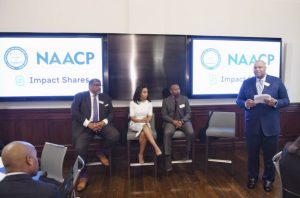 "NAACP Historic Wall Street Bell Ringing Panel Discussion ""Using Capital Markets to Create Social Equity."" Jim Casselberry, CIO of the Sarowitz Family LLC, former stock trader for Rosenblatt Securities Lauren Simmons, who made history as the youngest and only full time female NYSE trader, Guaylon Arnic, Co-Portfolio Manager at Profit Investment Management and Moderator Reggie Browne, Managing Director at Cantor Fitzgerald & Co (standing)."