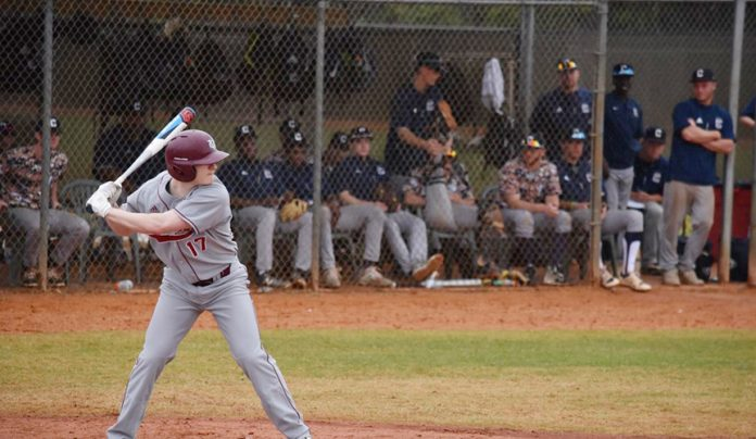 Vassar dropped the opening game 7-6, before exploding for a 14-3 win in game two.