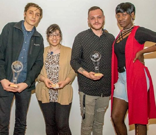 Film award winners (from left to right): SUNY New Paltz student Joshua Dudzik (3rdplace), Newburgh Free Academy student Anais M. Cantres (2ndplace) and winner Brandon DeSouza from Pine Bush High School with event MC, Moochie Merchant.