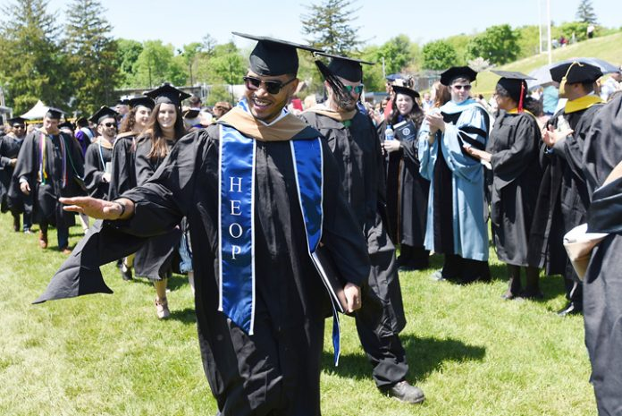 Dre Carpio of Beacon, N.Y., an academic counselor with Mount Saint Mary College's Higher Education Opportunity Program (HEOP), graduated with a Master of Business Administration degree. Photo: Lee Ferris
