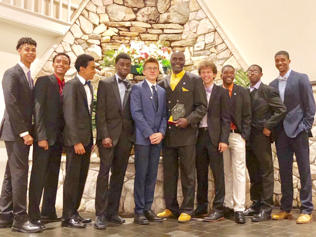 On Sunday, May 5, Newburgh Free Academy Track and Field Coach, Malcolm Burks, was inducted into the Friends of Section IX Track & Field Hall of Fame for his unwavering dedication to his athletes-on and off the track- as well as the sport at its Third Annual Induction Ceremony. He is surrounded by some of the many student athletes he has been coaching this school year.