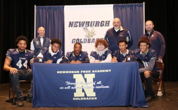 Six athletes from Newburgh Free Academy's Varsity Football team have committed to play football in college.