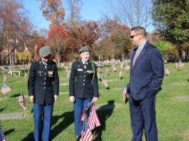 Pictured with Orange County Executive Steven M. Neuhaus are (from left to right) Minisink Valley High JROTC students Elena Cruz, a senior, and junior Lexie Toller at last year's Memorial Day event at the County's Veterans Memorial Cemetery.