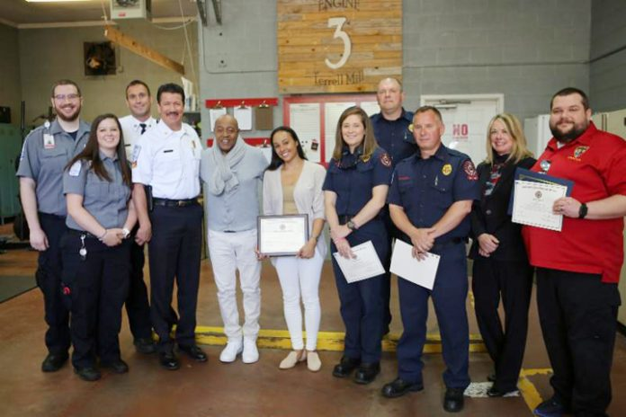 (From Left to Right): Logan Rogers (1st Responder Paramedic), Kayla Williams (1st Responder Advanced EMT), David Beranek (Cobb County Field Supervisor - behind Kayla), Chief Randy Crider (Cobb County Fire Dept.), Peabo Bryson, Tanya Boniface Bryson, Kim Bowie (1st Responder Firefighter), Anthony Helms (1st Responder Firefighter - behind Kim), Rich Ferguson (1st Responder Paramedic Engineer), Destiny Davidson (911 Director) and Chris Hayes (911 Supervisor and Dispatcher) pose for a photo.