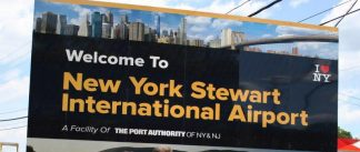 """Last year, """"We're going global,"""" were the first words spoken by Stewart Airport Manager Ed Harrison when he gave the okay for Port Authority crew members to unveil the new sign at the Bruenig Road entrance to the airport. It is now officially rebranded as """"New York Stewart International Airport."""""""